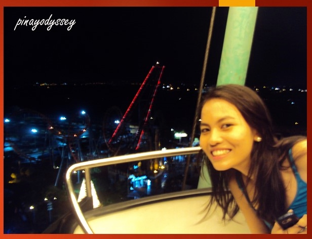 My sister on the wheel.. with the Space Shuttle in the background.