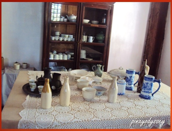 A dining table filled with porcelain kitchen wares