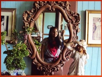 A selfie in a beautiful, old mirror