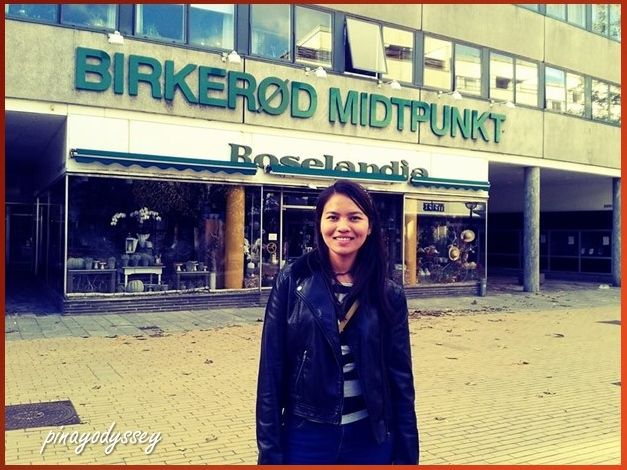 My sister posing in front of the Midtpunkt