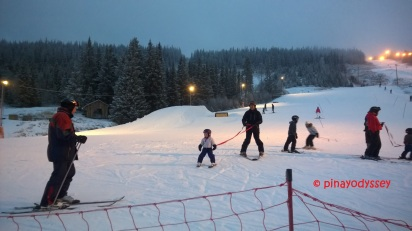 3 year old gliding down the big slope