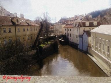 A smaller canal also under the bridge