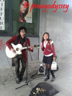 Posing with a street performer