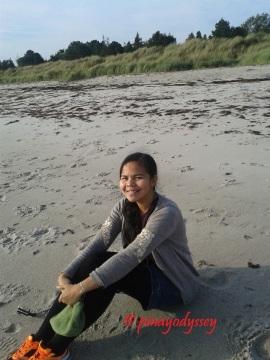 At the beach in woolen top ;) Brrr....