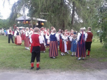 Latvians in their colorful national costumes
