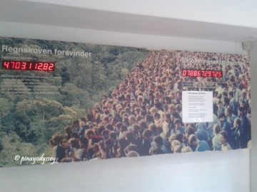 An info board showing the decreasing area of the world's forests vs the increase in human population