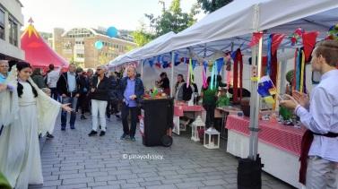 European food booths, with Ukrainian dancers