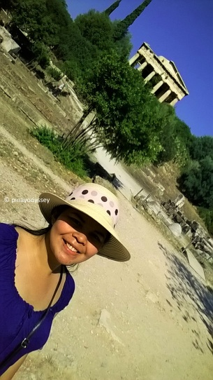 Just me at ancient Agora. with the Temple of Hephaestus on the background