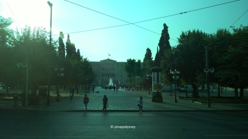 The Greek Parliament through the tainted glass of the bus window
