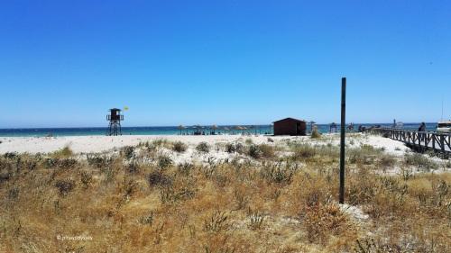 Zahara de los Atunes, with a chiringuito (mini bar) and beach huts and watchtower
